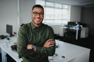 Portrait of young and successful businessman in modern office
